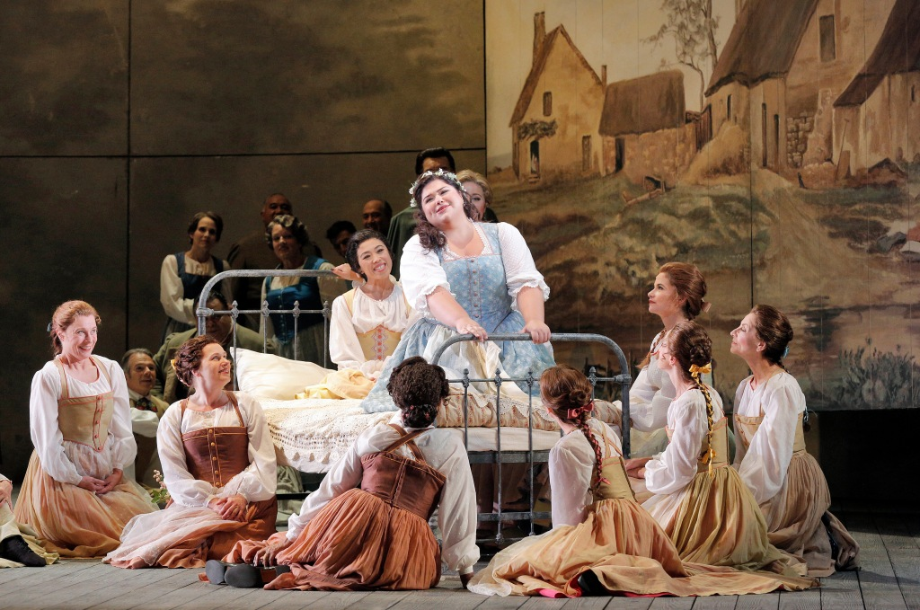 "Soprano Leah Crocetto is Luisa in Verdi's ""Luisa Miller"" at San Francisco Opera through September 27, 2015. Crocetto is a former Adler fellow and Merola alum. As the opera opens, it is Luisa's birthday and the villagers (San Francisco Opera chorus) have gathered to serenade her. The Francesca Zambello production, from 2000, features sets by Michael Yeargan with gorgeous huge paintings. Photo: Cory Weaver, SFO"