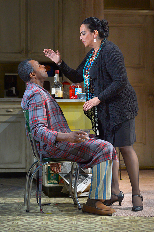 "The Church Lady (Catherine Castellanos) prays for Walter ""Pops"" Washington (Carl Lumbly, left) in Stephen Adly Guirgis' Pulitzer Prize–winning dark comedy,"