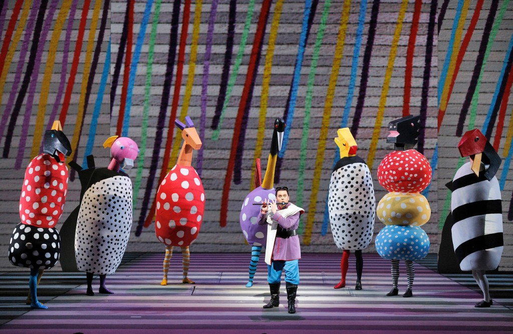 Lyric tenor Paul Appleby (front center) makes his San Francsico Opera as Tamino and plays his magic flute for a host of colorful oversized animals of the forest which never fail to delight audiences. ©Cory Weaver/San Francisco Opera