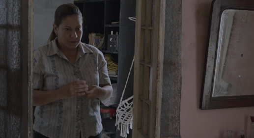 """There are three Cuban films at PIFF 7. Edith Mazzola is Estela in Joacenith Vargas' short film """"Estela"""" (2014). The shy middle-aged woman tries to isolate herself from the outside world. When she is called upon to break into her elderly neighbor's house, who suffers from Alzheimer's, she reconnects with childhood memories and experiences an awkward and brief moment of intimacy with a stranger. (Screens Sunday, October 18, 2:30 PM.) Image: Palm Springs Int'l Film Festival"""
