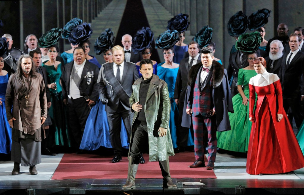 "Act 2's sextet ""Chi mi frena in tal momento"" (""What restrains me at this moment""), one of Italian opera's greatest ensemble moments, set in Ravenswood Castle. Piotr Beczala (Edgardo) in foreground. Then, from left to right─Nicolas Testé (Raimondo) in brown; Brian Mulligan (Enrico) with blond hair and beard, Chong Wang (Arturo) in plaid; and Zanda Švēde (Alisa) in red dress. Photo: Cory Weaver, SFO"
