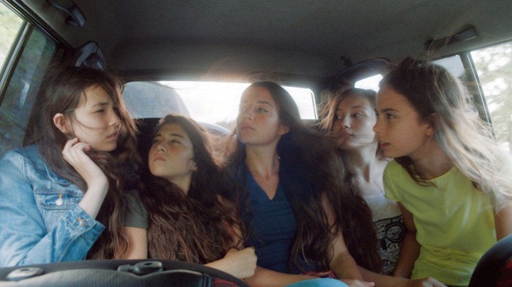 Five beautiful sisters on the verge of womanhood in an Anatolian village by the sea suffer from their guardians' attempts to lock them away to protect their virginity. image: MVFF