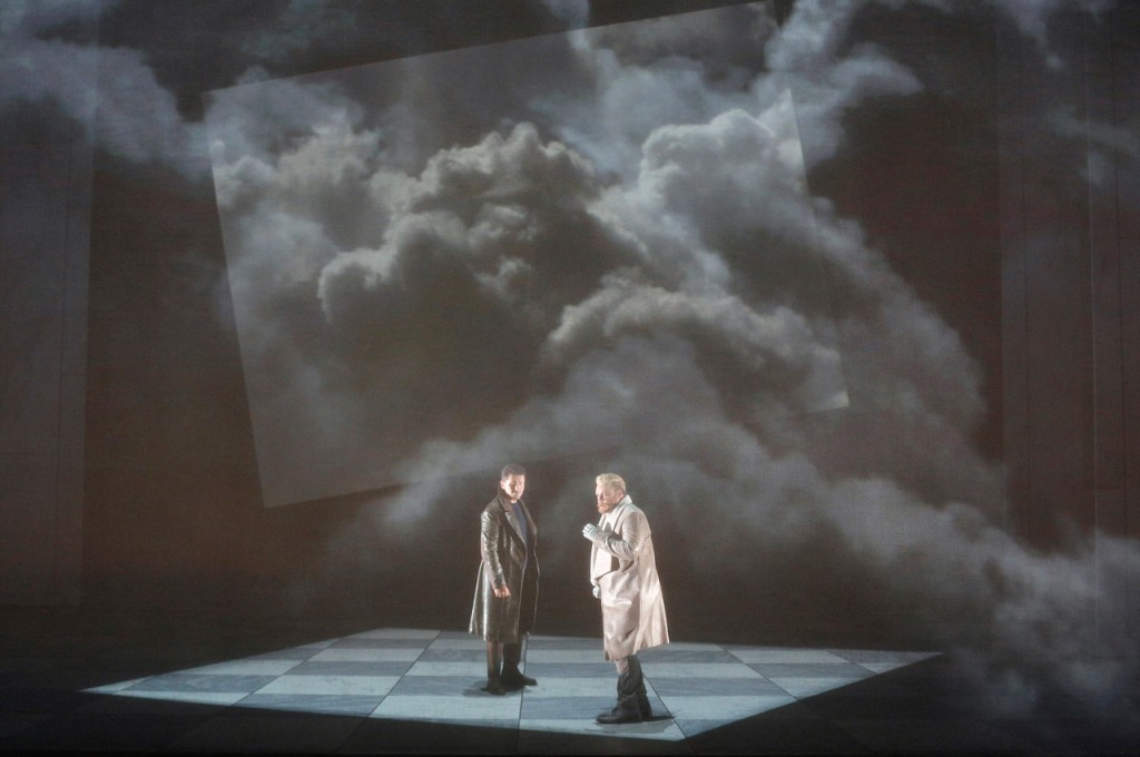 In Act 3, Lucia's lover, Edgardo (of Ravenswood), Polish tenor Piotr Beczala, is challenged to a duel by her brother, Enrico, American baritone Brian Mulligan at Wolfscrag, where Edgardo lives. The opera's plot is driven by an intergenerational feud between the Ravenswoods and the Ashtons of Lamermoore, making Lucia's love for the Edgardo forbidden and driving Lucia's brother to go extremes to ensure that she ends her relationship with Edgardo. Director Michael Cavanaugh and designer Erhard Rom set this new SFO production in a dystopian near future; the staging has a clean stark feel that is accentuated by dramatic lighting and projections of natural landscapes. Photo: Cory Weaver, SFO