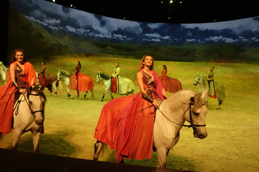"Cavalia's ""Odysseo"" celebrates the magical bond between human and horse with a show of artistry and athleticism. Costumed horses and riders gallop across the stage performing elaborately choreographed moves in coordination with acrobats, dancers and musicians. Stunning digital backdrops evoke journeys to places such as the Mongolian steppes, Easter Island and an African savanna. It all takes place in the White Big Top, the world's largest touring tent, the size of an NFL football field. The set is comprised of 6,000 pounds of rock, earth and sand. In one of the acts, an actual lake, of substantial depth, forms in front of the audience and the horses and riders perform in the water. ""Odysseo"" runs through January 10, 2016 in the White Big Top near AT&T Park. Photo: Geneva Anderson"