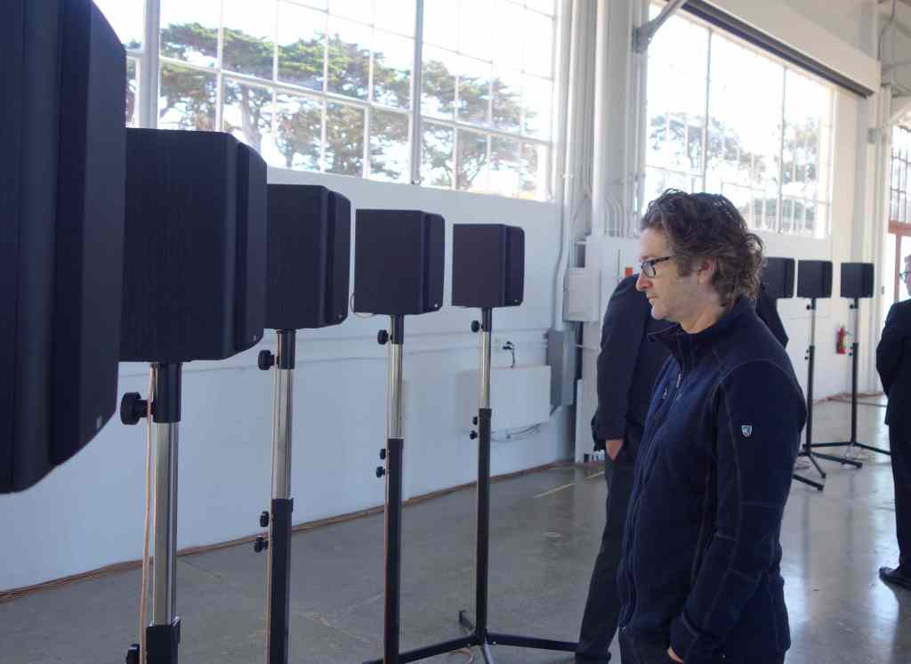 """Canadian artist George Bures Miller, Janet Cardiff's artistic partner and husband, in Gallery 308. """"The Forty Part Motet"""" when installed properly, makes Miller's spine tingle, even though he's heard it thousands of times. Photo: Geneva Anderson"""