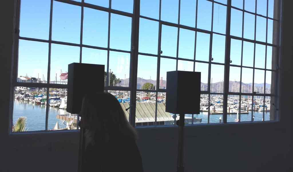 "Canadian artist Janet Cardiff's immersive sound installation,""The Forty Part Motet"" (2001), is at Fort Mason Center's new Gallery 308, which has views of the Marina neighborhood and the Bay. Regarded as Cardiff's masterwork, and consisting of forty high-fidelity speakers positioned on stands in a large oval configuration throughout the gallery, the piece is a reworking of Tudor composer Thomas Tallis' famous choral composition ""Spem in Alium"" (""In No Other is My Hope""). Visitors can walk along the loudspeakers and hear the singers' individual voices as well as the layered magic of the combined voice. Co-presented by Fort Mason Center for Arts & Culture and the San Francisco Museum of Modern. Photo: Geneva Anderson"