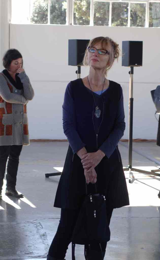 """Canadian artist Janet Cardiff in Fort Mason Center's new Gallery 308 at the media preview, listening to """"The Forty Part Motet,"""" which is up through January 18, 2016. Cardiff, down to earth and centered, is a huge believer in the emotional power of music. She created """"The Forty Part Motet"""" in 2001 and the piece has since traveled the world. Photo: Geneva Anderson"""