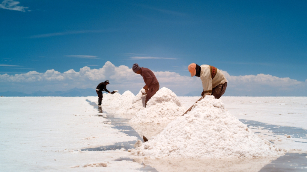 "A scene from Mike Plunkett's documentary ""Salero"" which has its West Coast premiere and screens three times at SFIFF 59. The film follows the story of Moises Chambri Yucra, a Quechean Indian, one of Bolivia's last saleros─men who harvest salt from the vast plateau Salar de Uyuni. Underneath this snow white expanse are the gargantuan lithium deposits that some speculate will turn Bolivia into a kind of Saudi Arabia, as it reaps the revenue from this scarce mineral that is necessary for batteries and other industrial uses. The shots of the Bolivian salt flats are other worldly. Director Mike Plunkett and producer Anna Rose Holmer will both be in attendance. Photo: courtesy: SFFS"
