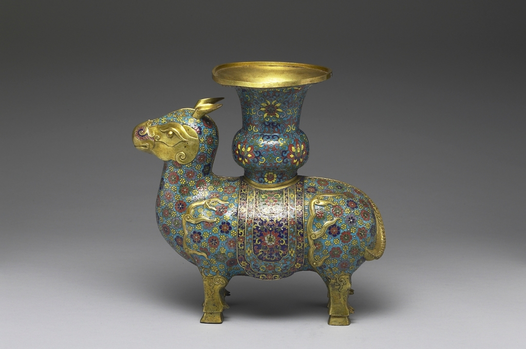 Copper vessel in the shape of a xizun, an ox-like mythical beast, by the Imperial Workshop, Beijing, Qing dynasty, reign of Emperor Qianlong (1736–1795). Based on a classical Bronze Age ritual wine-serving vessel. Qianlong court documents reveal that it was set on an altar in the main hall of the Imperial Ancestral Temple. The stylized floral patterns, filled with multicolored enamel cloisonné, represent the fine level of enamel inlay during the mid and late Qing dynasty. The beast displays design elements commonly found in Persian objects. National Palace Museum, Taipei. Photograph © National Palace Museum