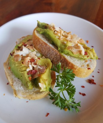 For Taste, CorkScrew will serve Vegan Avocado Coconut Toasts ─avocado & toasted unsweetened coconut with red pepper flakes on Full Circle Bakery baguette. The avocado toast pairs very nicely with their white tap wine, an unfiltered and unfined Sauvignon blanc. Photo: Geneva Anderson