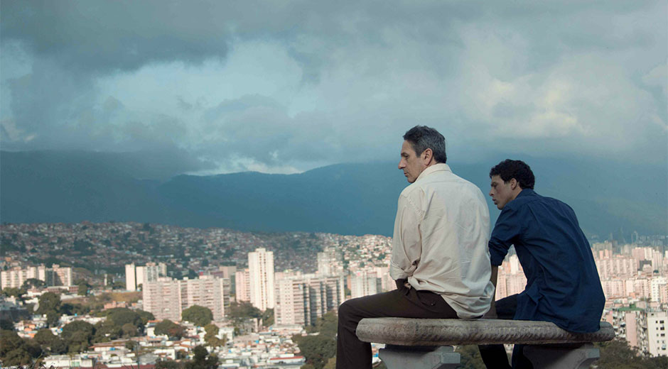 "Venezuelan director Lorenzo Vigas' ""Desde Allá"" (""From Afar"", 2015) picked a Coral award for best ""Opera Prima"" ""debut film"" at the 37th Festival of New Latin American Cinema. Winner of the Golden Lion at the Venice Film Festival, this richly textured first feature explores the relationship between a lonely middle-aged man (Chilean actor Alfredo Castro) who trolls the streets of Caracas looking for young men for sex and meets his match in a young bi-sexual hustler (Luis Silva) who has a girlfriend. The young man manages to shift the balance of power between the two and the story takes unexpected twists as their emotional baggage is laid out."