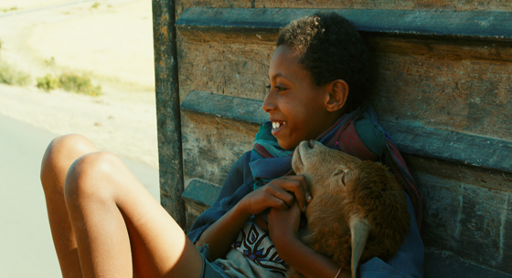 """Ethiopian writer-director Yared Zeleke's feature debut film, """"The Lamb"""" (2015) will screen twice at the 39th Mill Valley Film Festival, and the filmmaker will attend both screenings and participate in an audience Q & A. """"The Lamb"""" wasthe first Ethiopian film ever named an official Cannes selection, made a huge splash at Cannes in 2015. This drama, which unfolds in Amharic, the national language of Ethiopia, is the story of a young boy, Ephriam (Rediat Amare), who, after his mother's death, is left to live with his cousins while his father heads off to Addis Abba in search of work. He becomes attached to a goat, Chuni, and when his relatives make plans to sacrifice the goat, he and Chuni go on the run. Much of the film is an exploration of family life in Ethiopia, a land of stunning landscapes and drought-stricken arid areas, where the labor-intensive electricity-free lifestyle is far removed from that in the West. The film is especially recommended for families. Image: MVFF"""